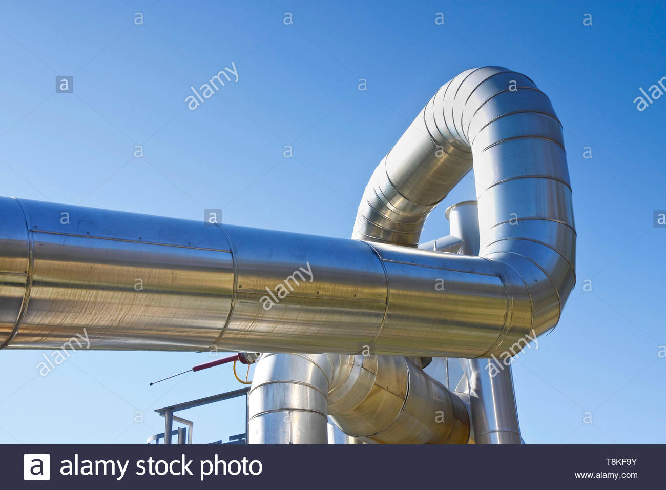 Geothermal power pipe structure against a blue background Stock 1300x956