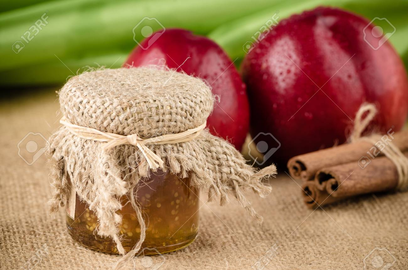 Peach Jam With Fruit And Cinnamon Over Raffia Background Stock 1300x861