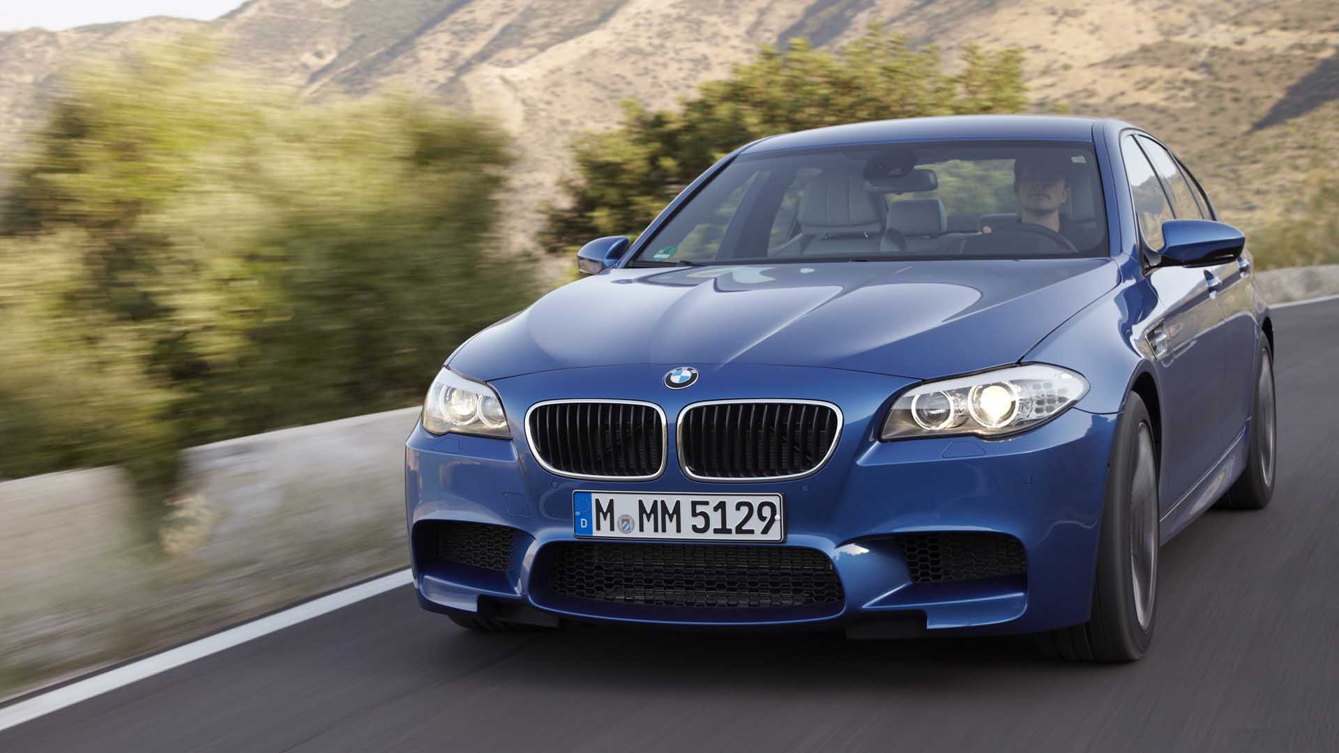 Blue BMW m5 amazing car running on a road while racing 1920x1080