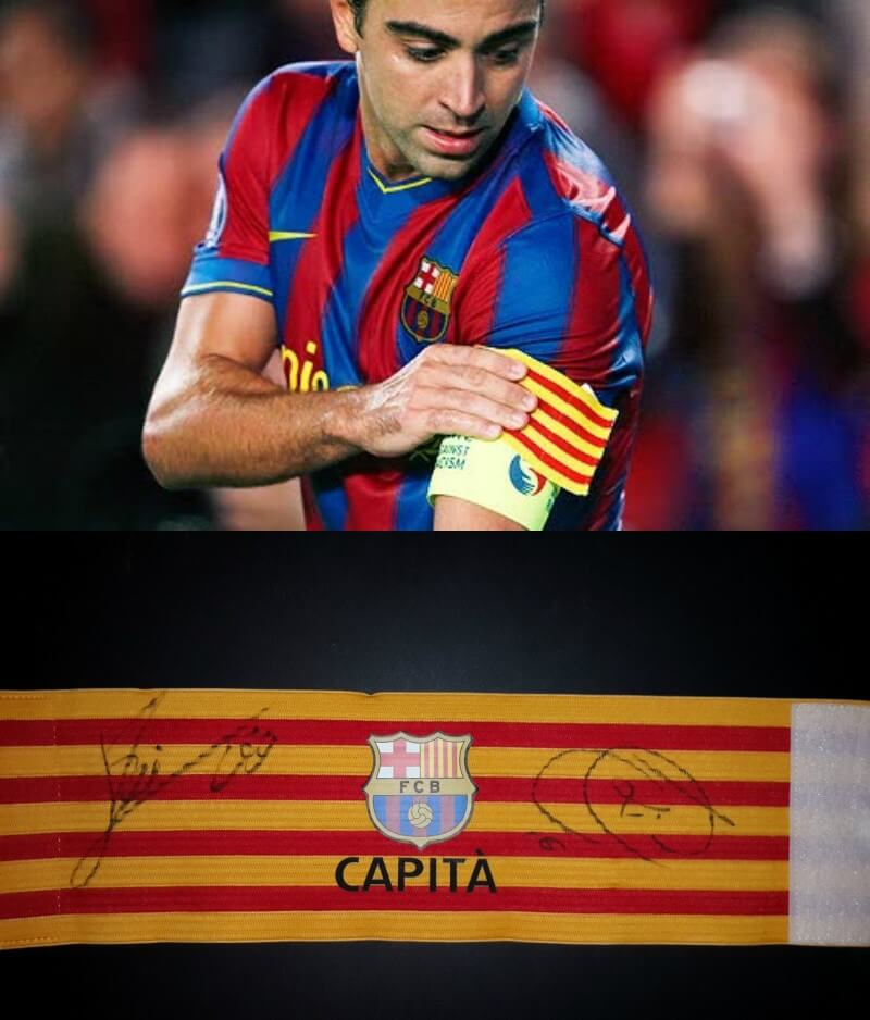 A Xavi Game Used FC Barcelona Captain Armband Signed by Messi 800x938