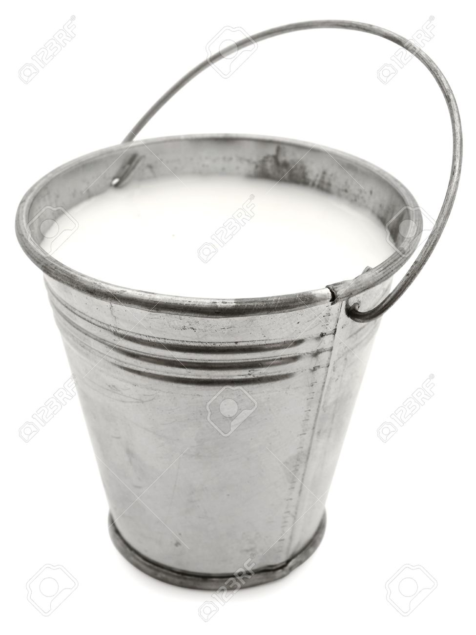Metal Bucket With Milk Against The White Background Stock Photo 975x1300