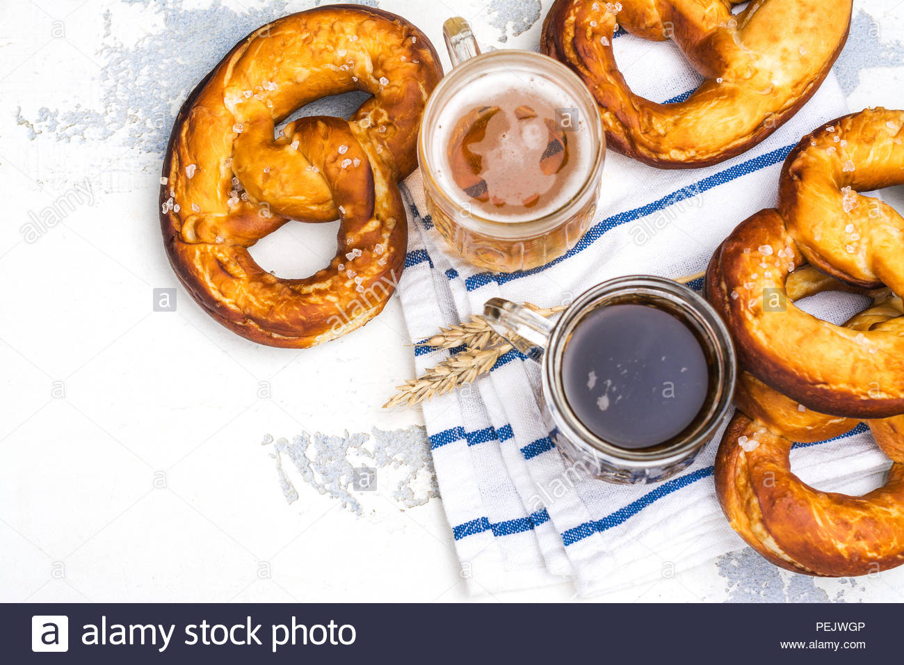 Beer and pretzels on white background Oktoberfest party Stock 1300x956