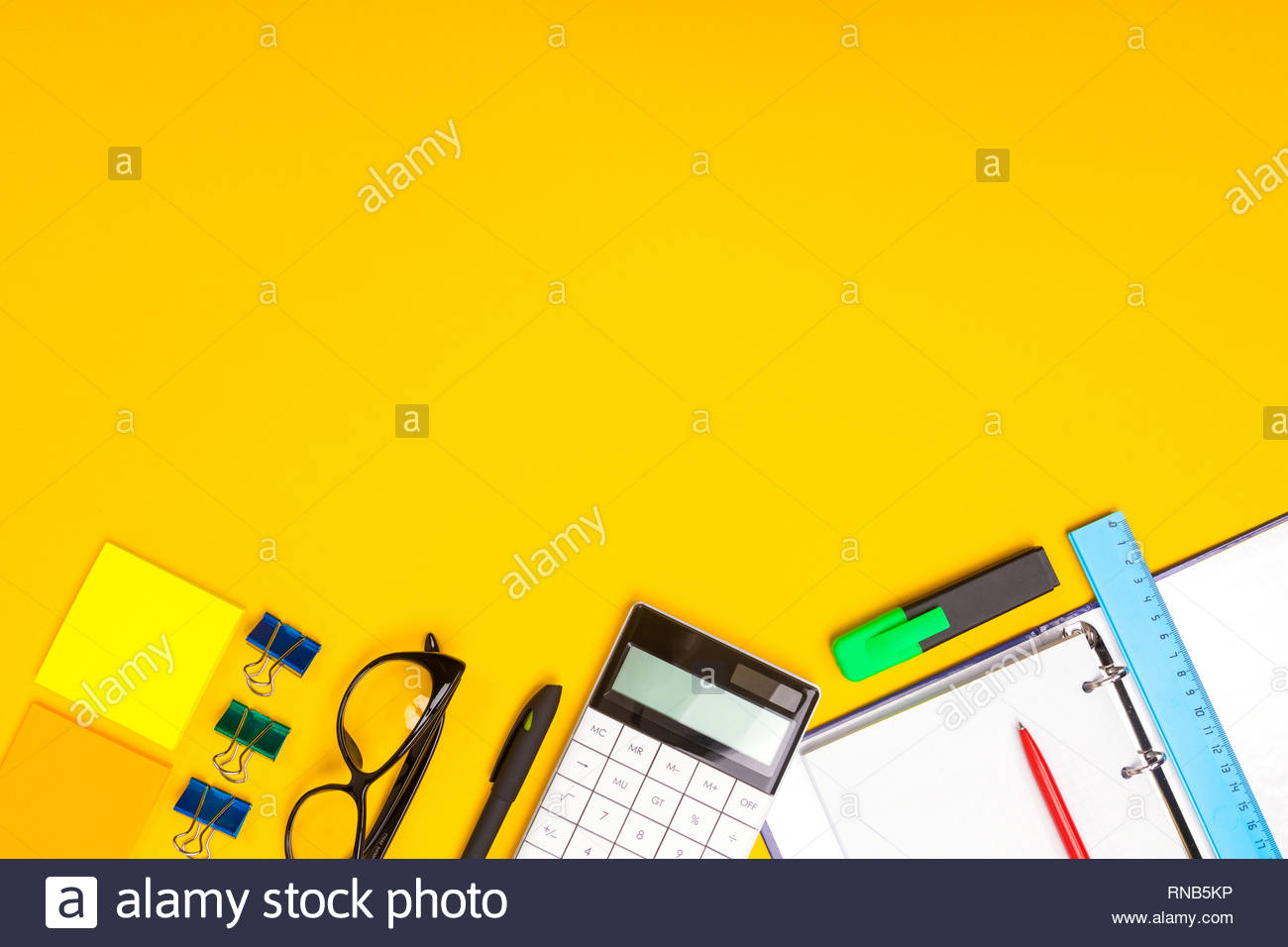 School office supplies on yellow background ready for your design 1300x956