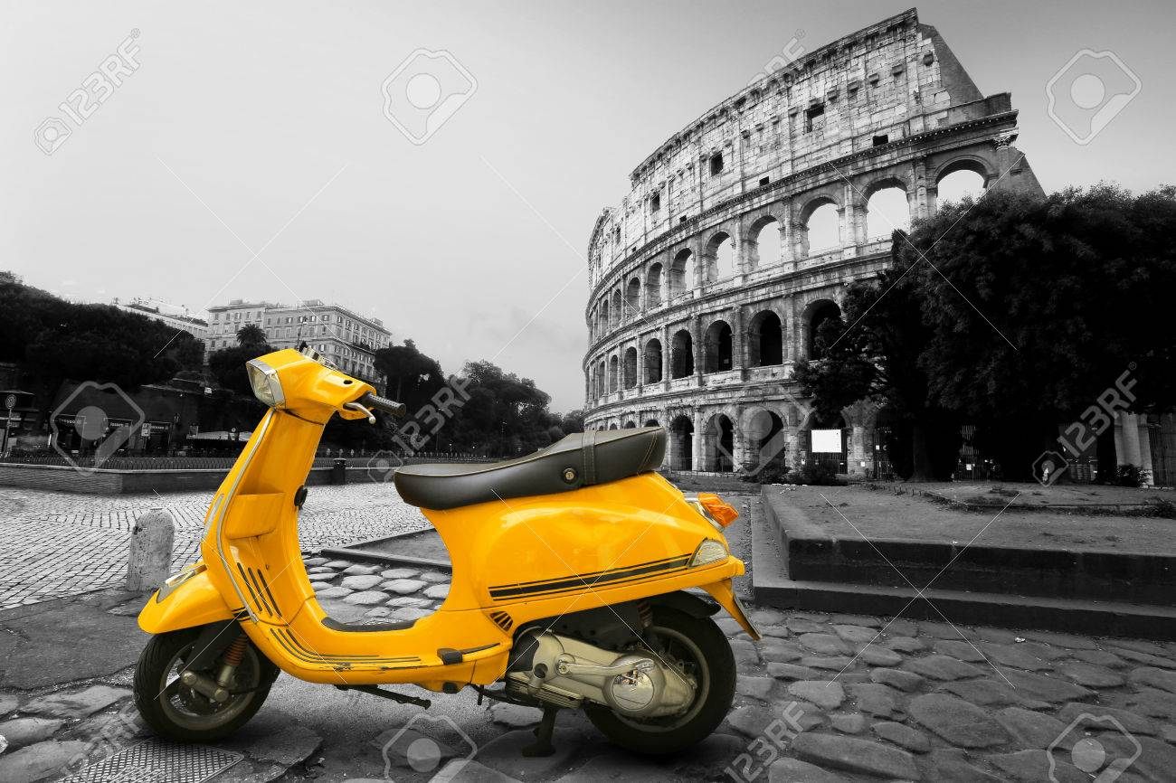 Yellow Vintage Scooter On The Background Of Coliseum Stock Photo 1300x866
