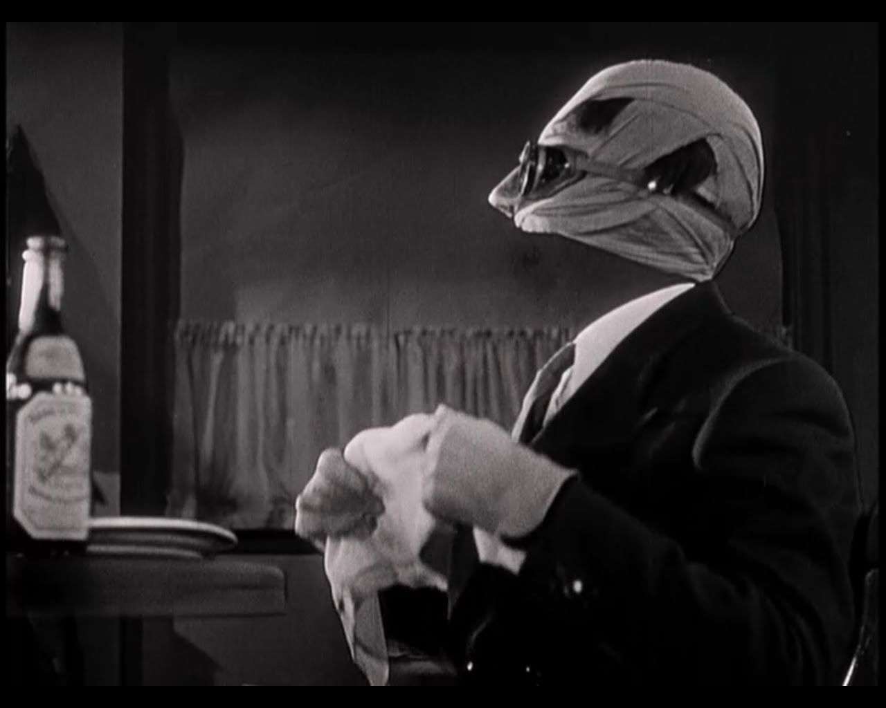 Claude Rains as Jack GriffinThe Invisible Man in The Invisible Man 1280x1024