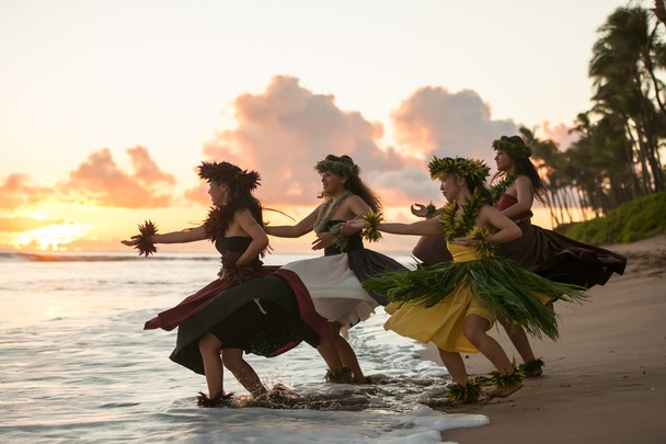 hawaiian hula halau performs a traditional hula dance at sunset on the 608x405