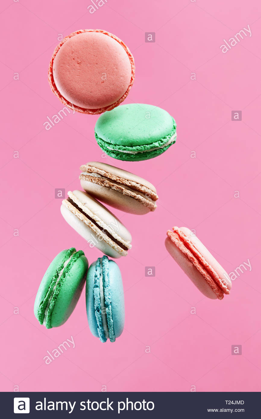 Traditional french colorful macarons on pink background Stock 866x1390