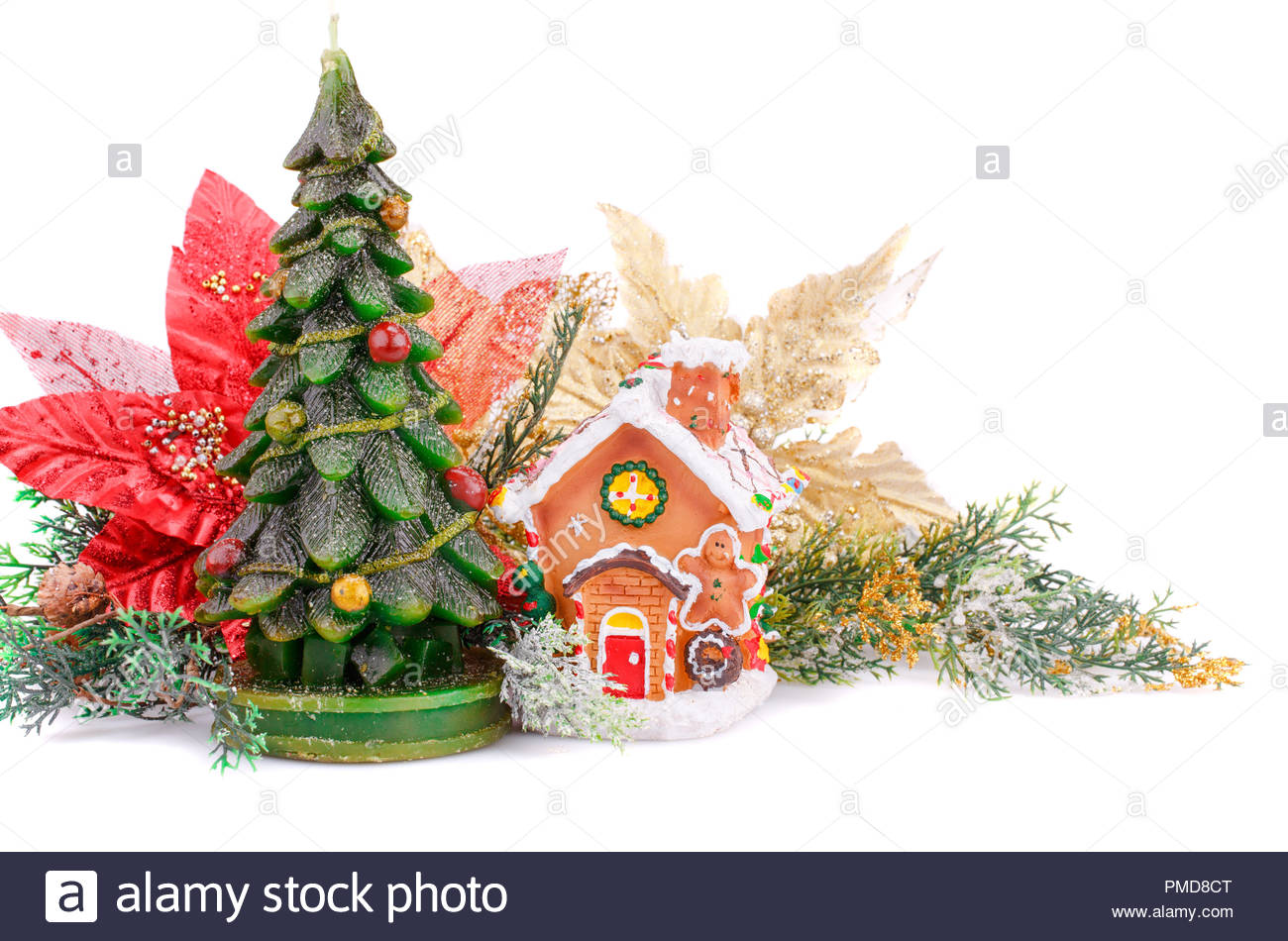 Fir tree candle toy house and holly berry flowers on white 1300x950