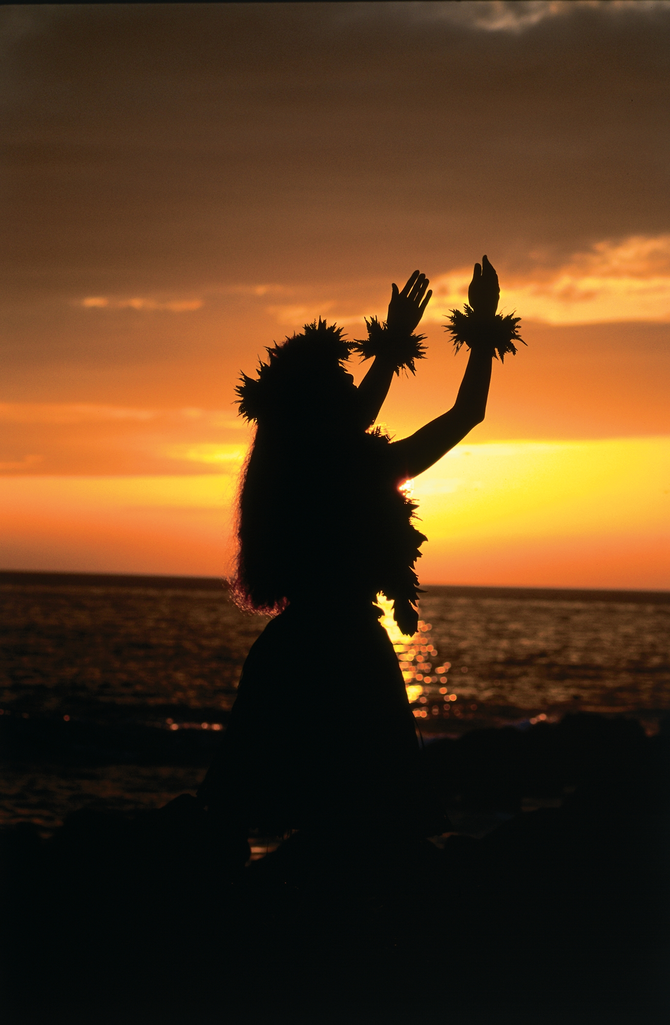 Silhouette of hula dancer girl against sunset background 1308x2000