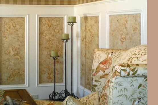 does an elegant distressed plaster over wallpaper in paneled areas 555x370