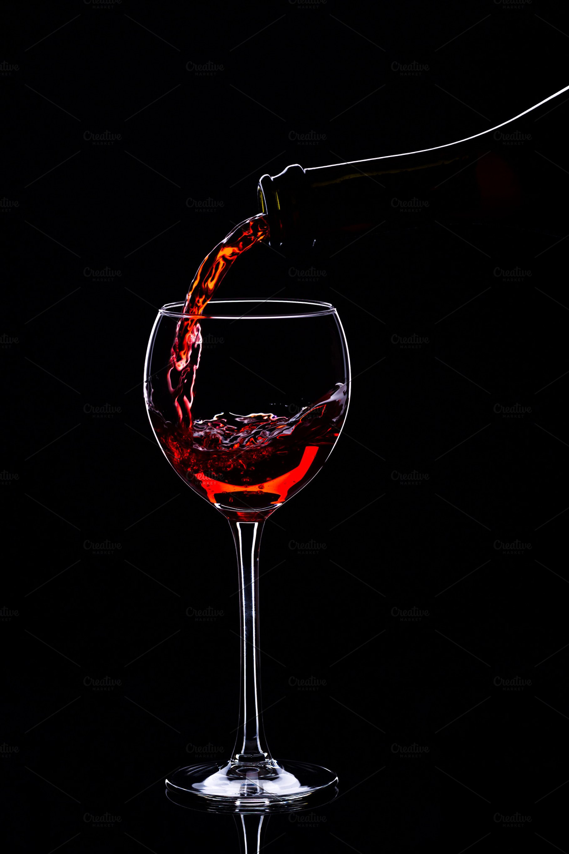 Wine glasses with wine bottle on a black background minimalism 1820x2730