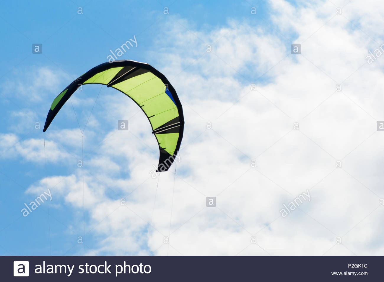 Kiteboarding kite close up blue sky with clouds in background 1300x956