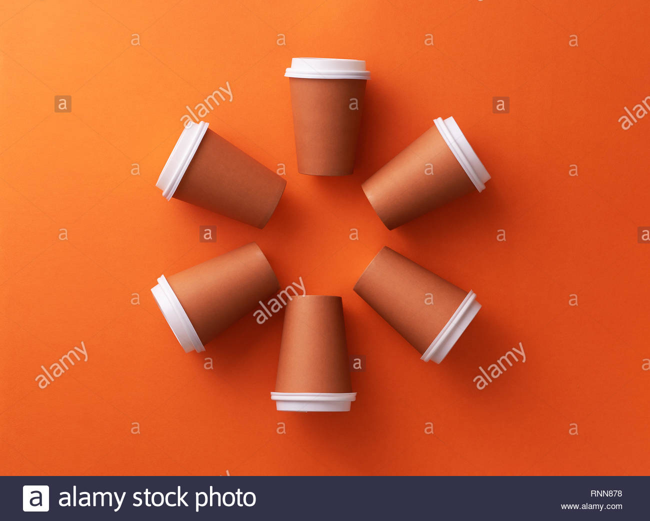 Multiple disposable coffee cups organized in a circle orange 1300x1042