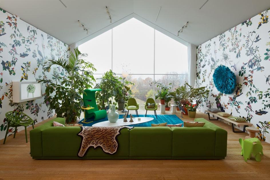 Green sofa white blue living room patterened wallpaper Interior 944x629