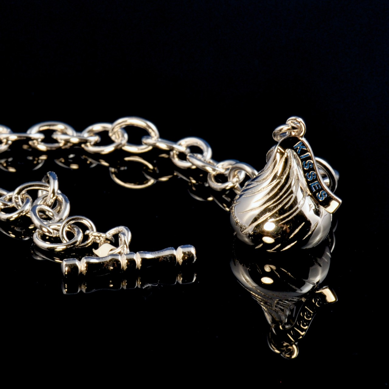 Kiss sterling silver bracelet photographed on glossy black background 1280x1280