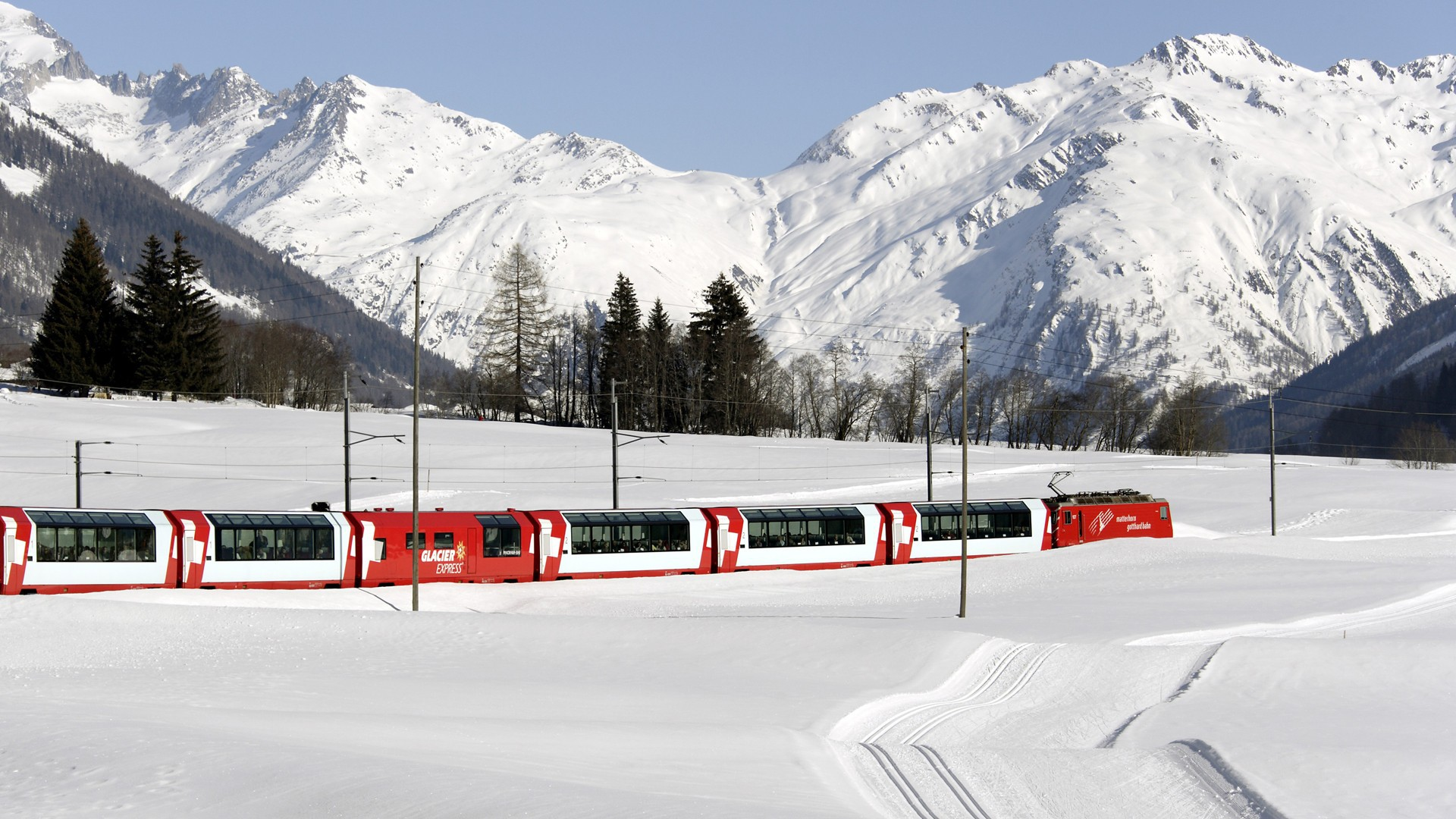 Passenger train in the snow in Switzerland wallpapers and images 1920x1080