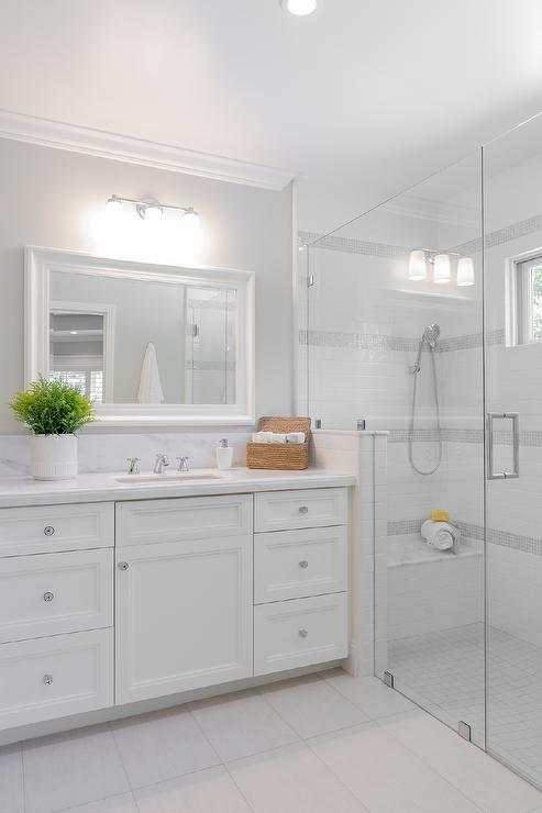 White Subway Tiles with Gray Border Tiles   Transitional   Bathroom 493x740