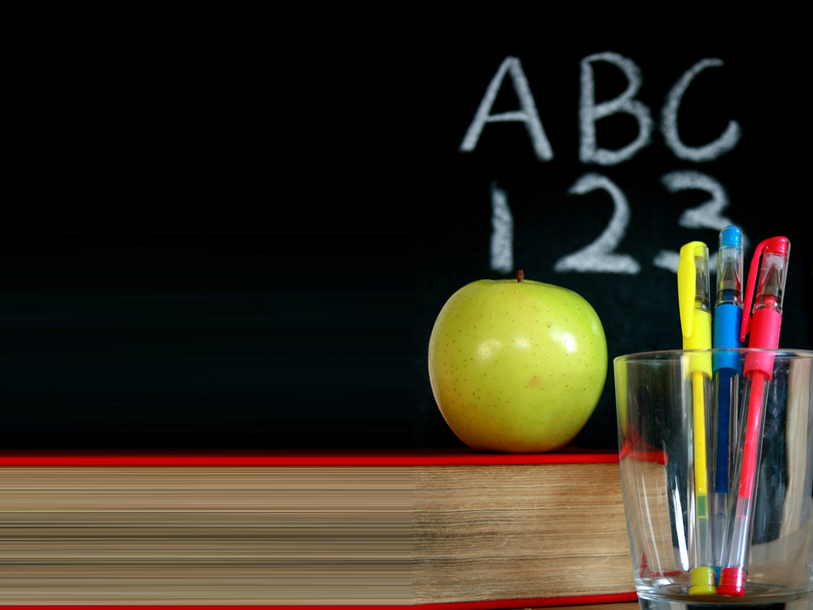 Chalkboard with a green apple and pens backgrounds 1600x1200