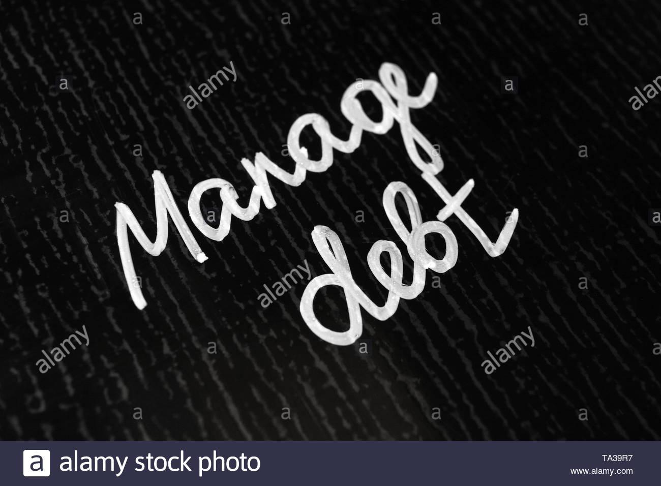 Text MANAGE DEBT on dark background Stock Photo 247165275   Alamy 1300x956