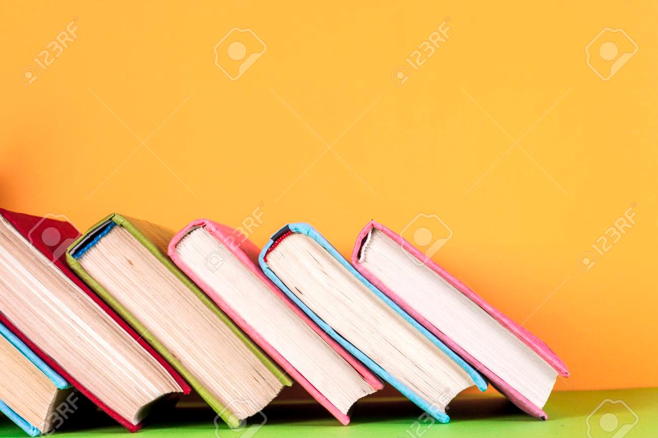 Set Of Colored Books On Bright Colorful Background Back To School 1300x866