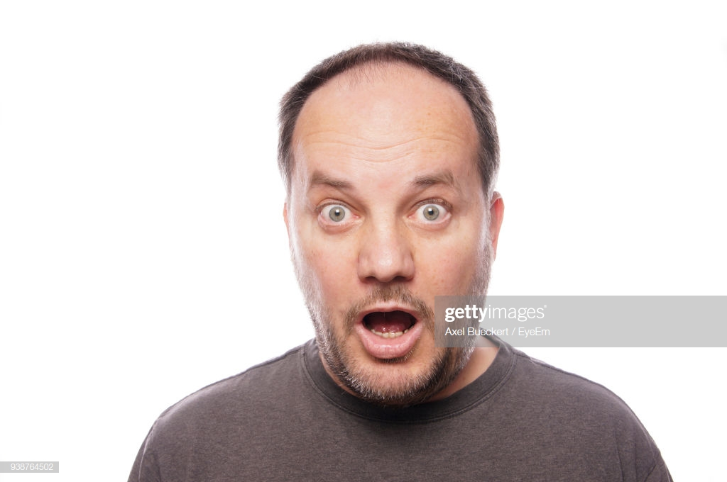 Portrait Of Shocked Man Against White Background Stock Photo 1024x680