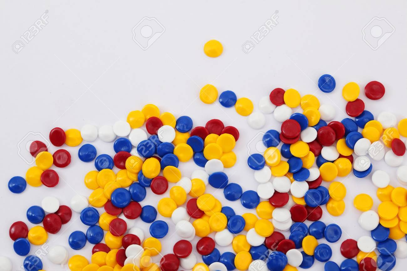 Colorful Plastic Polymer Granules On White Background Stock Photo 1300x866