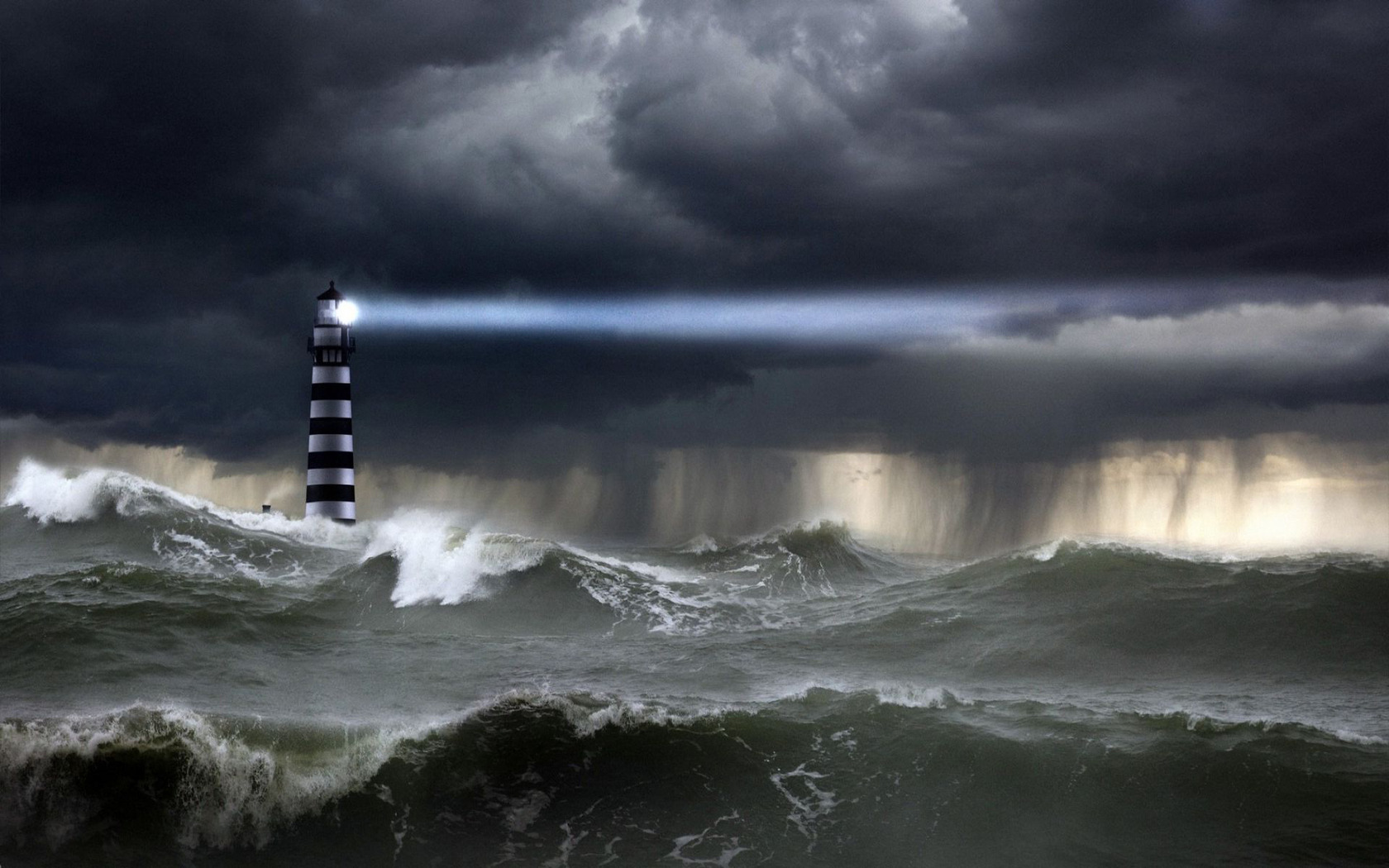 Download Lighthouse in the storm wallpaper 1680x1050