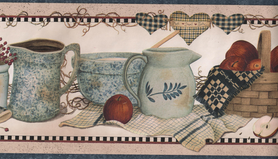 collection of blue pottery accented with a basket of apples linens 562x322