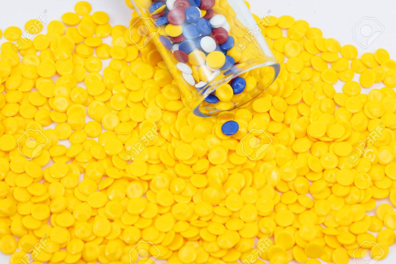Colorful Plastic Polymer Granules On Yellow Grunules Background 1300x866