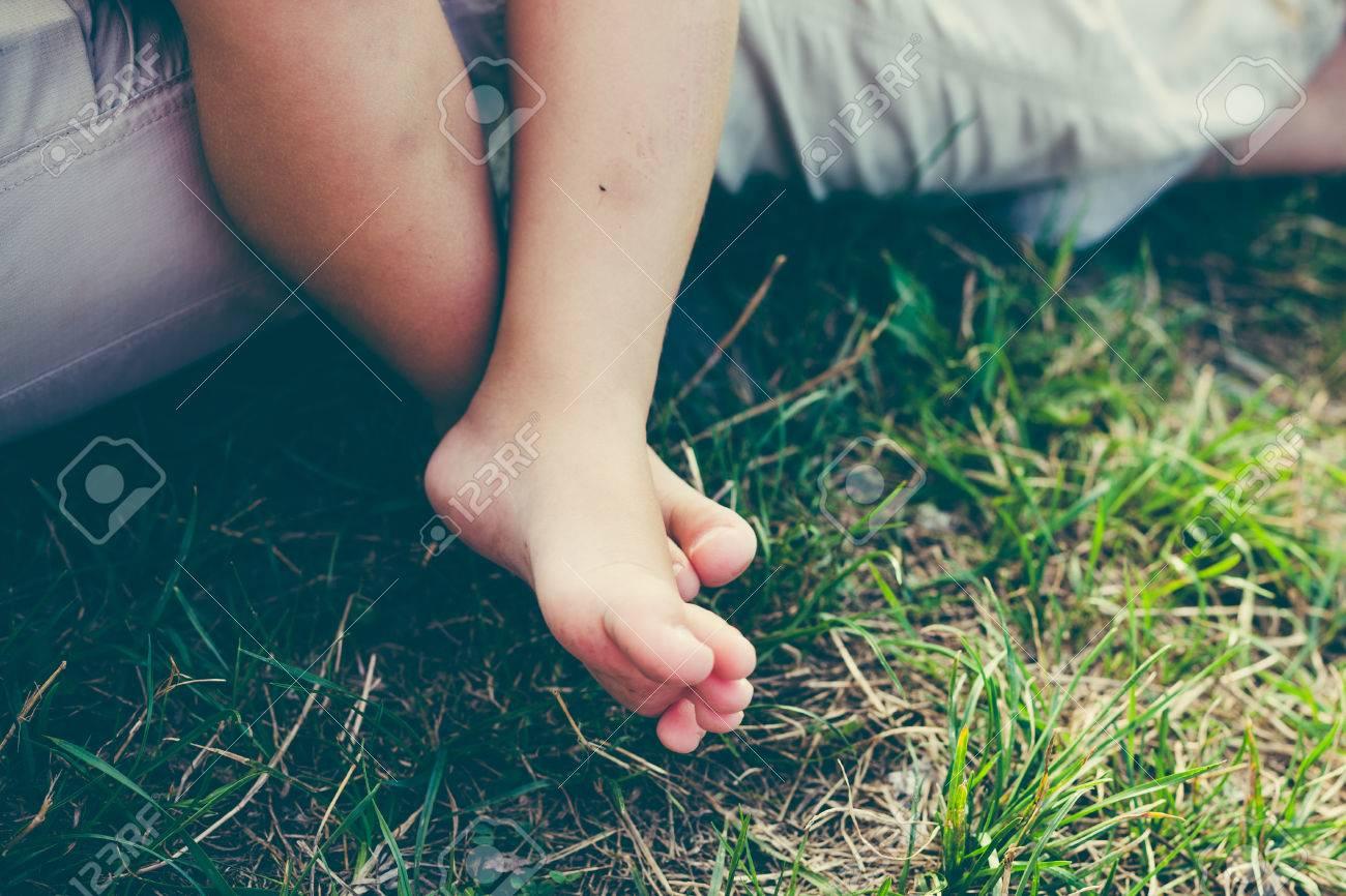 Little Girl Barefoot Closeup Feet On Grass Background Relaxing 1300x866
