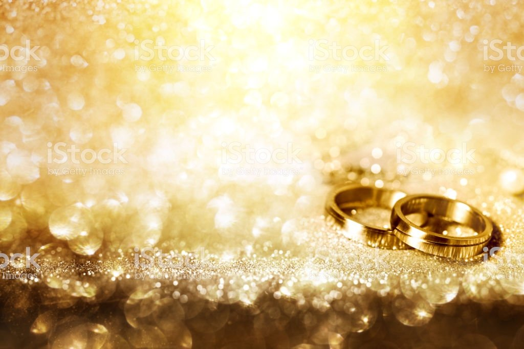 Wedding Rings On Festive Golden Background Stock Photo   Download 1024x683