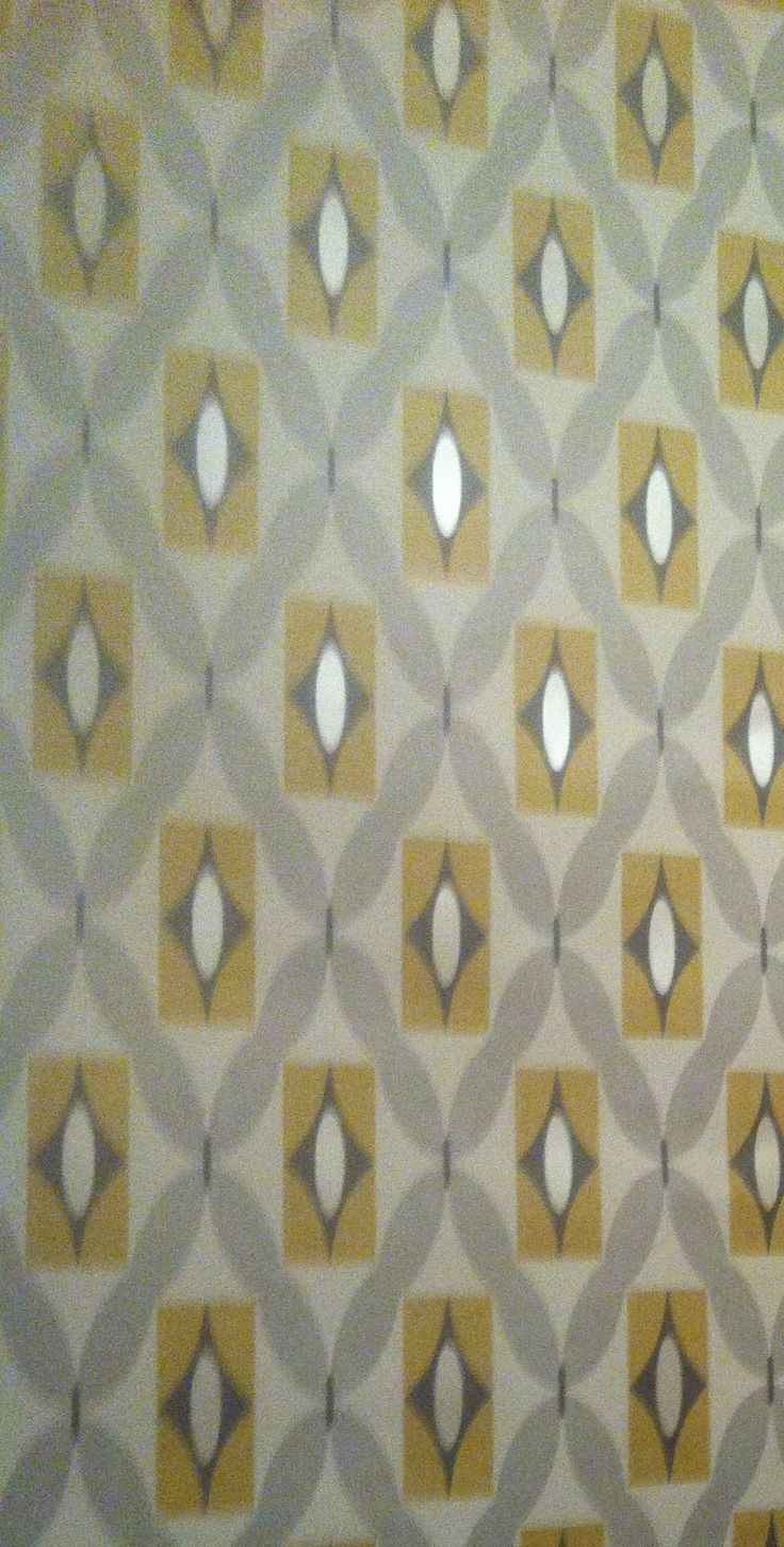 Feature wall grey and mustard Geometric print wallpaper from bq More 736x1451