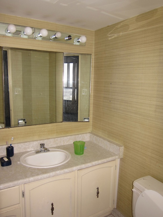 Before we removed the wallpaper and painted the walls of this bathroom 547x730