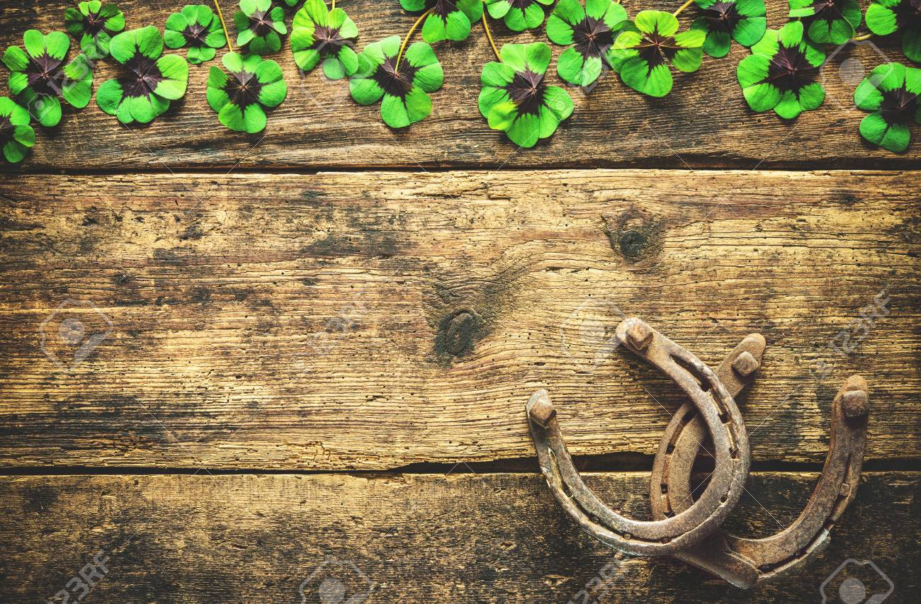 St Patricks Day Lucky Charms Horseshoe And Shamrock On Wooden 1300x853