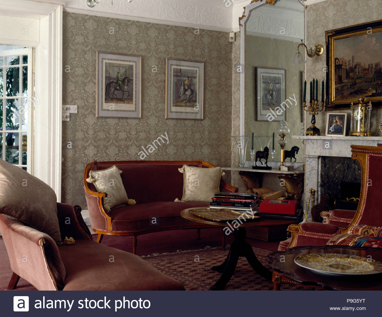 Velvet upholstered sofas in an old fashioned living room with pale 1300x1080