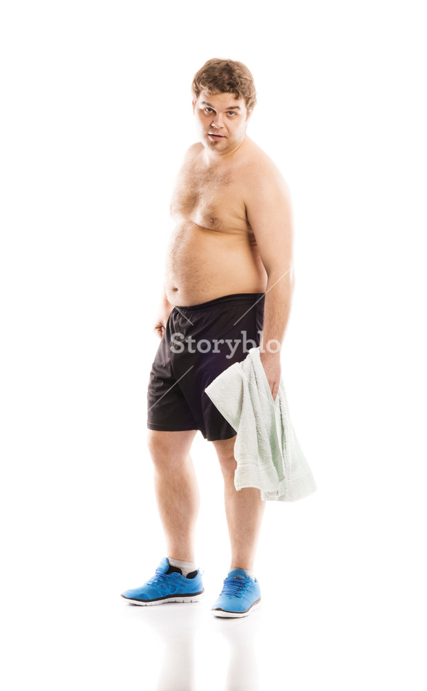 Fat fitness man is posing in studio on white background Royalty 618x1000