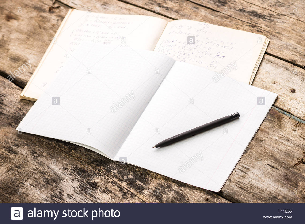 Open notebook with pen Mathematics homework school background 1300x956