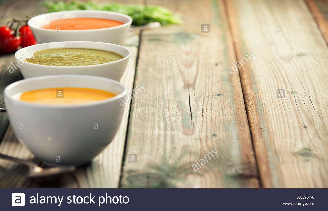 Variety of cream soups   tomato broccoli and pumpkin soups over 1300x836