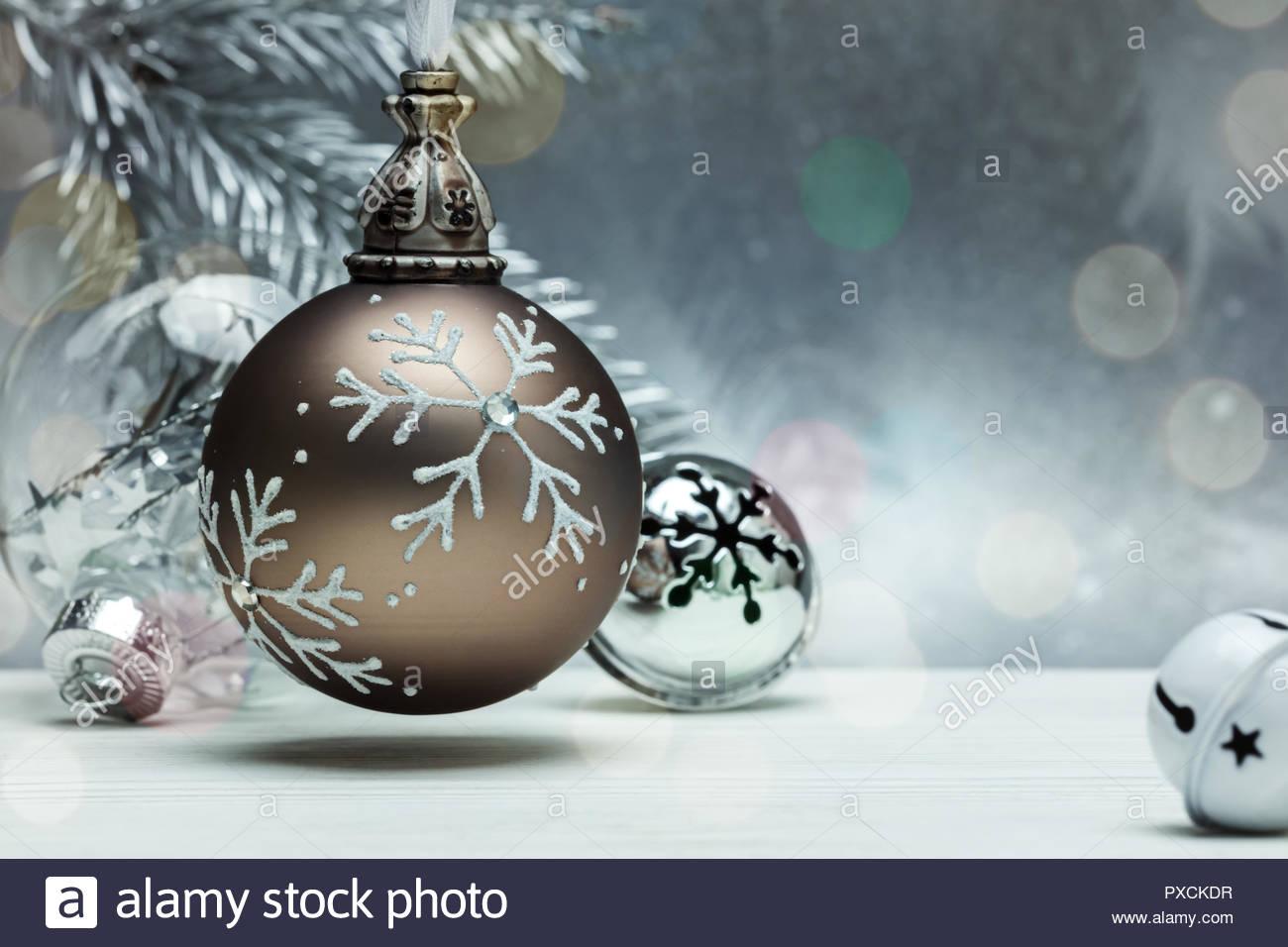 decorative glass balls and jingle bells for christmas tree on grey 1300x956