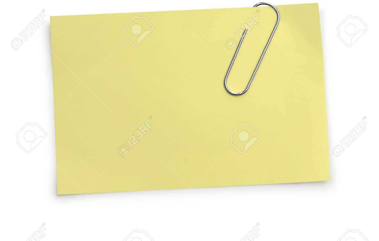 Paper Clip Holding A Yellow Memo Paper On A White Background Stock 1300x828