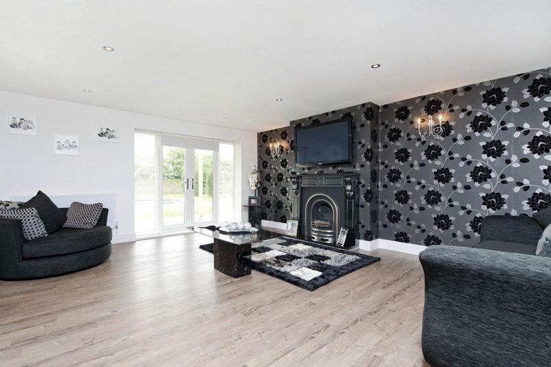room lounge with fireplace laminate flooring feature wall wallpaper 800x533