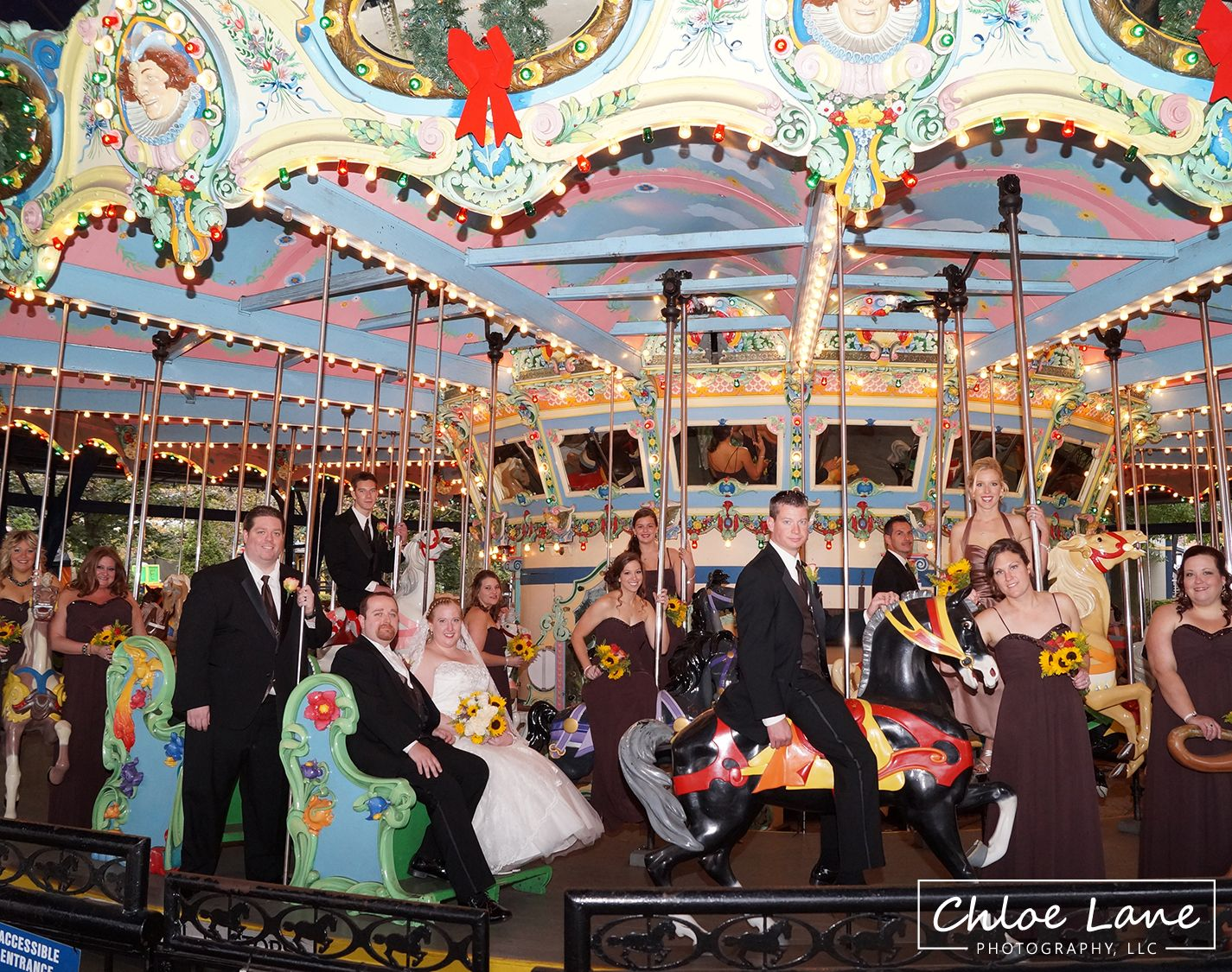 Wedding party riding the merry go round at Kennywood Park in 1425x1125