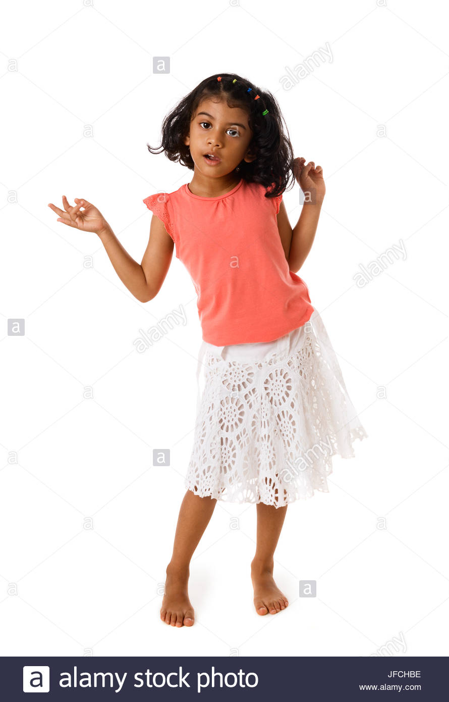 Cute little girl standing barefoot on white background Stock Photo 890x1390