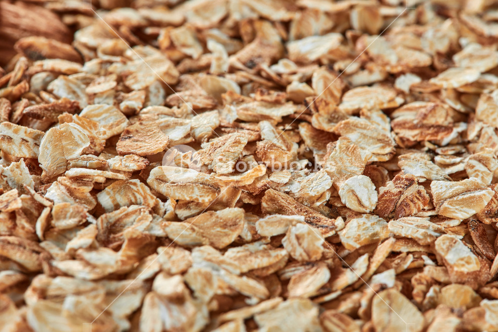 Raw oatmeal as a background copy space Oat cereal for dieting 1000x667