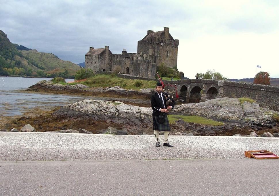 A Pipers Welcome To Eilean Donan Castle wallpaper other 970x680