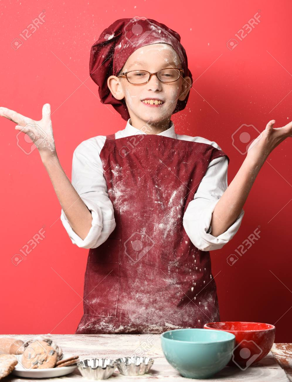 Young Boy Cute Cook Chef In Uniform And Hat On Stained Surprised 996x1300