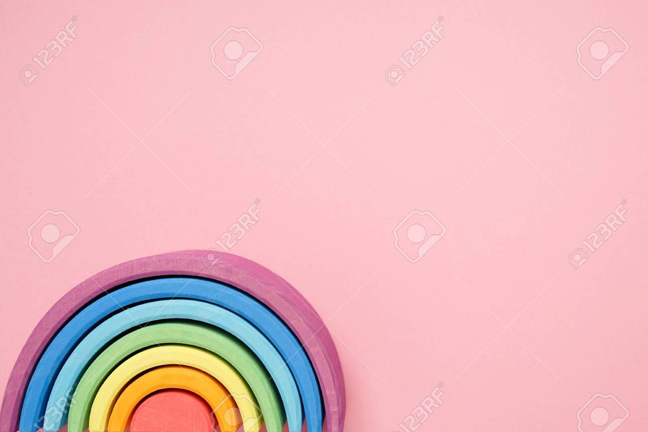 Pink Background And Waldorf Wooden Rainbow In A Montessori 1300x866