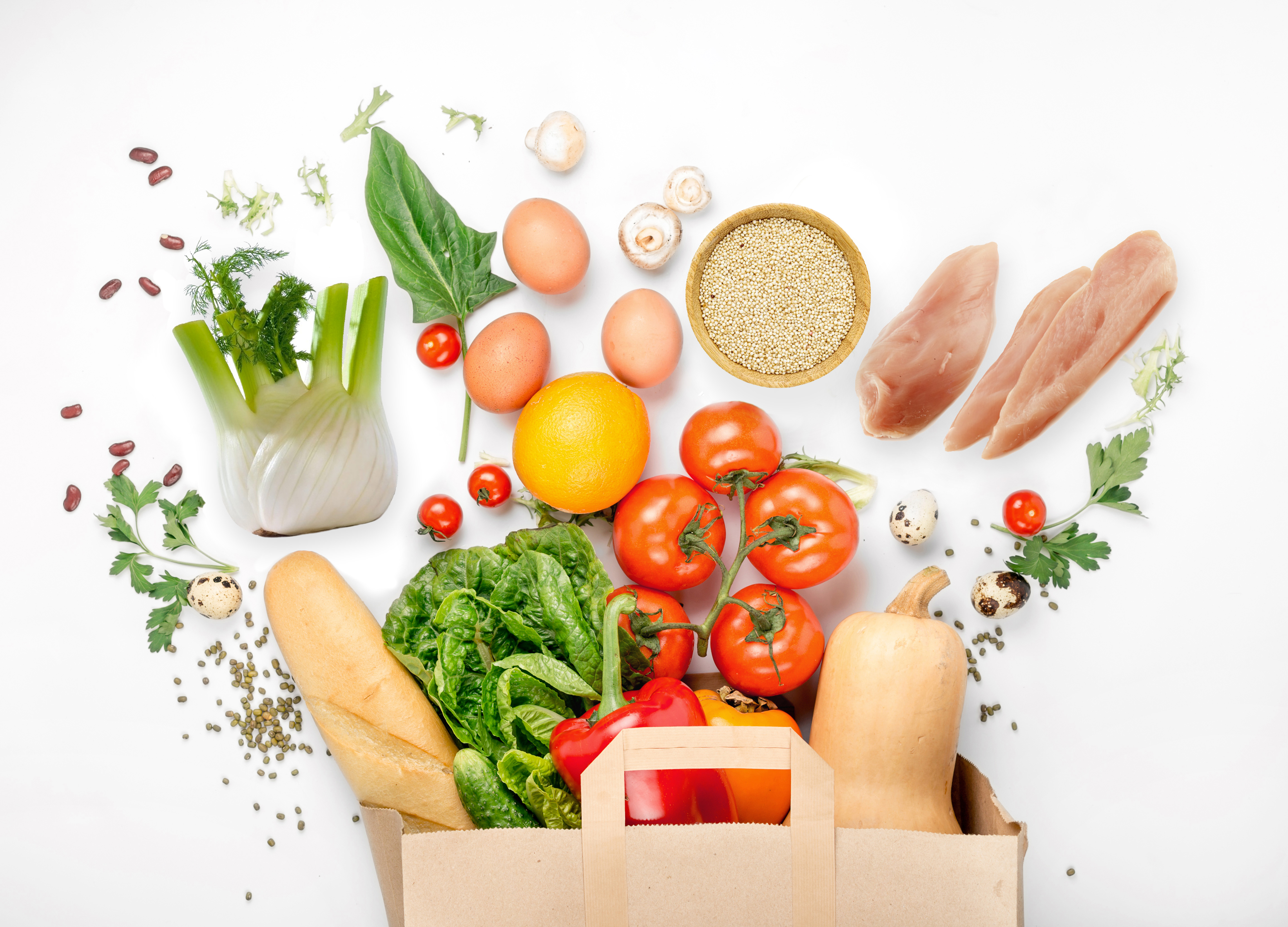 Full paper bag of different health food on white background Fit 4619x3323