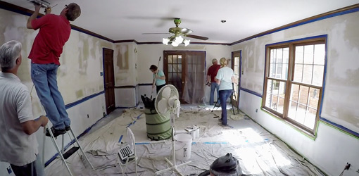Painting and other work in room with drop cloths covering floor 510x250