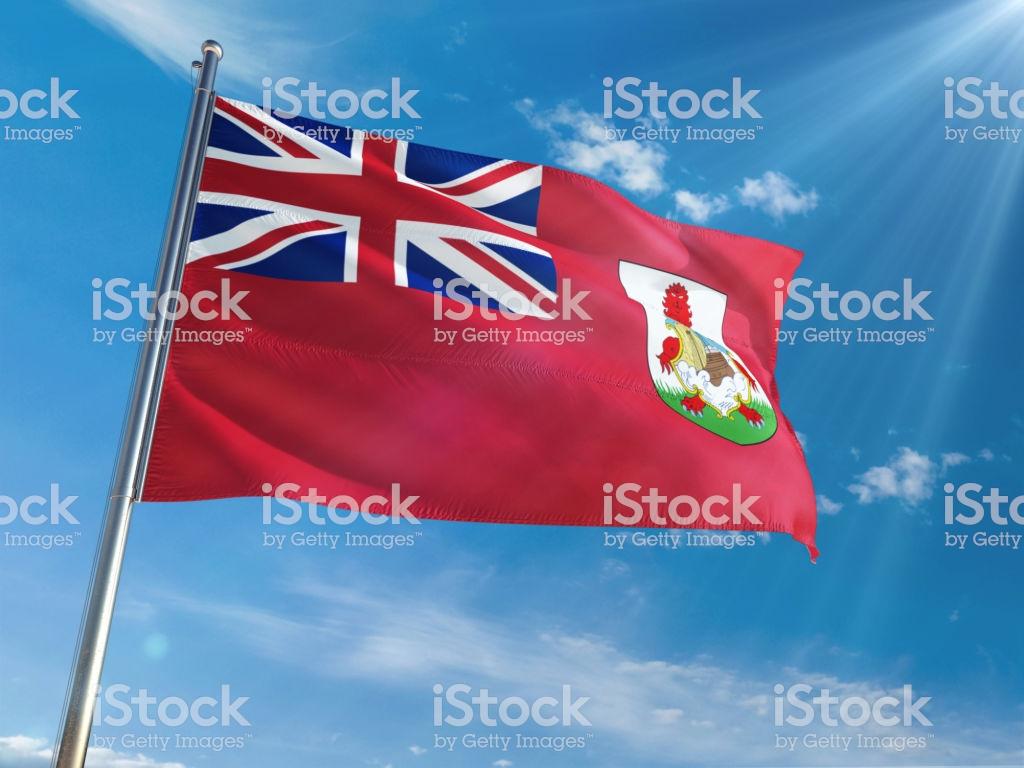 Bermuda National Flag Waving On Pole Against Sunny Blue Sky 1024x768